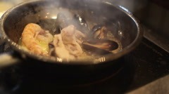 Seafood frying in a pan, close up Stock Footage