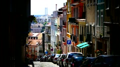 Portugal Lisbon Lisboa old town downtown narrow hilly road Arkistovideo