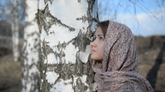 Russian girl in a scarf in a birch forest Stock Footage