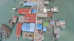 Aerial overhead view sea village dock Stock Footage