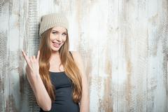 Cool hipster woman with nice hat is gesturing Kuvituskuvat