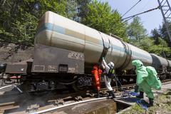 Toxic chemicals acids emergency team near train Stock Photos