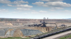 Excavator digging on open pit coal mine Stock Footage