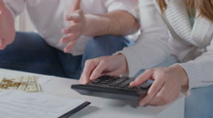 Closeup hands with calculator, husband wife plan family budget - stock footage