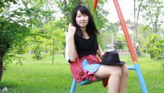 Thai student teen smile Sitting On Park Stock Footage