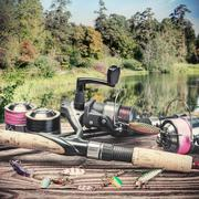 Fishing tackle and accessories on the table Stock Photos