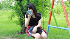 Unhappy Bored thai student teen Using Smartphone Sitting On Park Stock Footage