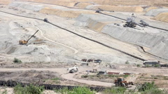 Open pit coal mine with machinery Stock Footage
