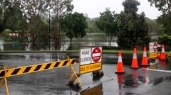 MORAYFIELD, AUSTRALIA - FEBRUARY 20: Cyclone Marcia causing flooding across park Stock Footage