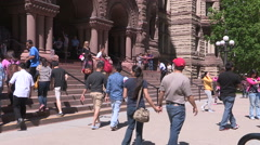Diverse crowds of tourists in downtown urban city of Toronto on summer day Stock Footage