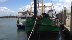 Fishing boat in Oude Schild on Texel Holland The Netherlands Stock Footage