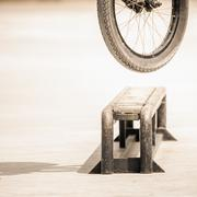Close-up of bicycle wheels doing trick by rail Stock Photos