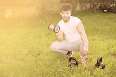 Young man exercising outdoor warm filter applied Stock Photos