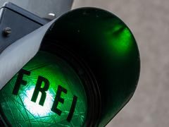 green light at a parking garage - stock photo