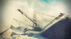 Stone crusher (rock stone crushing machine) at open pit mining and processing - stock footage