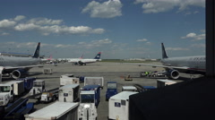 Dulles International Airport loading baggage on aircraft 4K 033 Stock Footage
