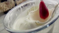 Strawberry falls into milk Slow Motion Macro Stock Footage