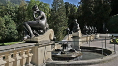Female figure statues as water fountains at Linderhof Castle, Bavaria Germany Stock Footage