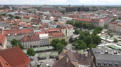 ULTRA HD 4K Aerial view Munich old town market street traffic silhouette red day Stock Footage
