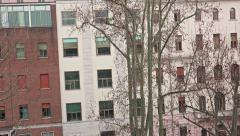 Stock Video Footage of 4k Zoom from appartment window. Establishment shot of building in America Man