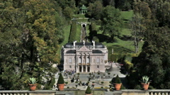 Linderhof Castle distant shot Tourists line up for entrance Germany Stock Footage