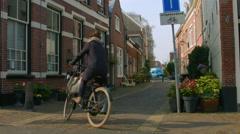 Bicycling on Nieuwe Raamstraat Haarlem Netherlands Stock Footage
