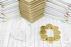 Bankruptcy of house and pile of gold coins as zero Stock Photos