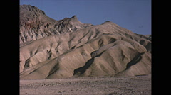 Vintage 16mm film, desert mountains x4 sequence, 1965 Stock Footage