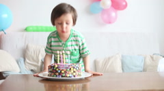 Beautiful adorable four year old boy in green shirt, celebrating his birthday Stock Footage