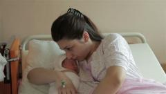 Newborn child sleeping in mother hands at maternity ward, close up, mom, baby. Stock Footage