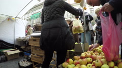 Farmer woman vendor sell healthy natural apple fruits in market Stock Footage