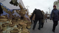 Wicker handmade baskets sold in market fair and people Stock Footage