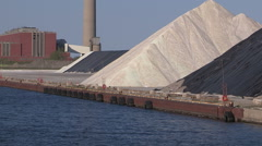 Road salt piled up on the dock in Toronto for the winter season Stock Footage