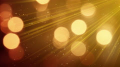Light rays and bokeh circles golden loopable background 4k (4096x2304) Stock Footage