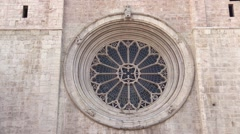 Trento, Italy - Cathedral of San Vigilio (rose window with wheel of fortune) Stock Footage