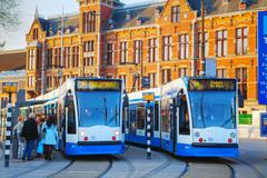 Stock Photo of Trams at the Amsterdam Centraal railway station in Amsterdam, Netherlands