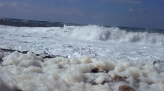 Waves rolling to the shore with foam in Cyprus, low angle Stock Footage