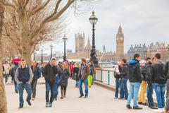 Thames riverbank crowded with people in London - stock photo