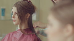 Hairdresser makes hairstyle of model Stock Footage