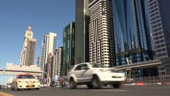 Traffic drives over the main highway crossing Dubai's financial district Stock Footage