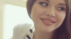 Close-up of a beautiful girl with full lips posing for a photograph Stock Footage