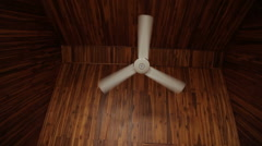 White fan rotates under a wooden ceiling Stock Footage