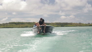 Stock Video Footage of man sitting at the front of driving boat