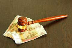Judge gavel and ruble banknotes on wooden table. Stock Photos
