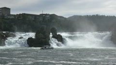 Tourboat takes tourists close to Rhine Falls near Schaffhausen,Switzerland Stock Footage