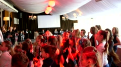 Kids boys and girls dancing on disco club hands in air move synchronously Stock Footage