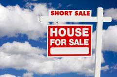 Stock Photo of Short Sale House For Sale Real Estate Sign on Clouds.