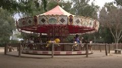 Kids on carousel merry go round 03 Stock Footage