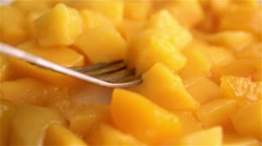 Plate of diced mangoes being eaten - stock footage