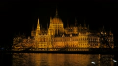 Lighted Parliament building in Budapest and river Danube by the night 4K 2160 Stock Footage